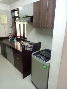 Gallery Cover Image of 1003 Sq.ft 2 BHK Apartment for rent in Neelsidhi Jai Balaji CHS, Nerul for 42000