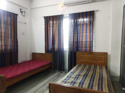 न्यू टाउन में शेल्टर लिविंग पीजी में बेडरूम की तस्वीर