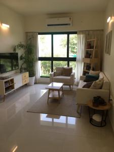 Living Room Image of 811 Sq.ft 2 BHK Apartment for buy in Godrej Green Glades, Jagatpur for 4711000