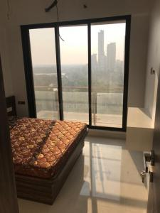Gallery Cover Image of 1500 Sq.ft 3 BHK Apartment for rent in Ghansoli for 48000
