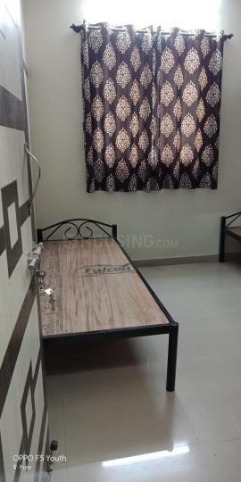 कोथरूड में एसके पीजी के बेडरूम की तस्वीर