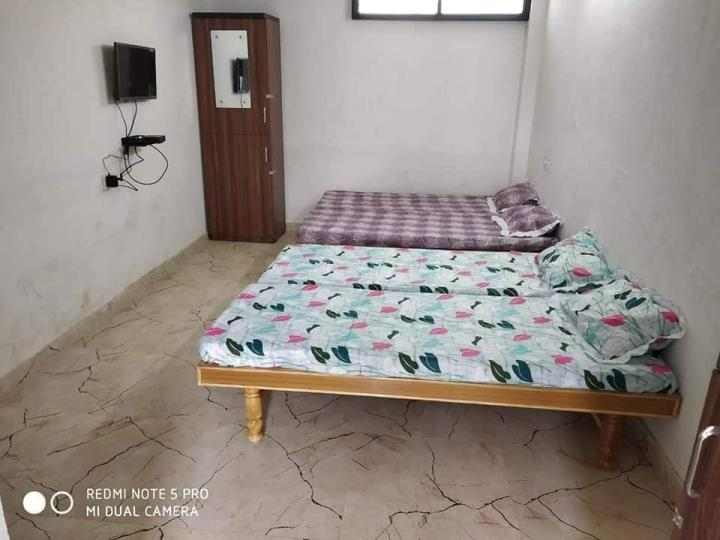 Bedroom Image of Aavas Paying Guest in Sarkhej- Okaf