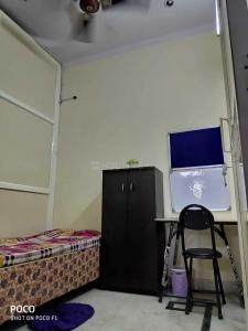Bedroom Image of Sharing Walls PG in Mukherjee Nagar