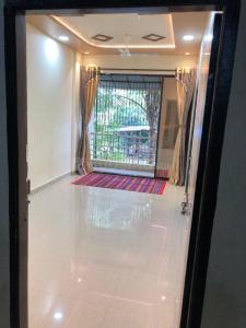 Gallery Cover Image of 690 Sq.ft 1 BHK Apartment for rent in Vangani for 4500