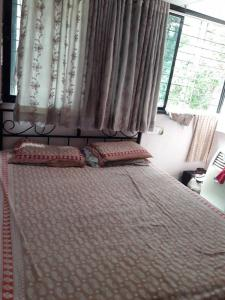 Gallery Cover Image of 560 Sq.ft 1 BHK Apartment for rent in Kandivali West for 21000