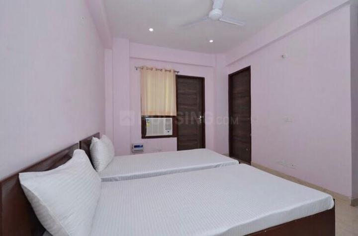 सुशांत लोक आई में द सेफ हाउस गर्ल्स पीजी के बेडरूम की तस्वीर