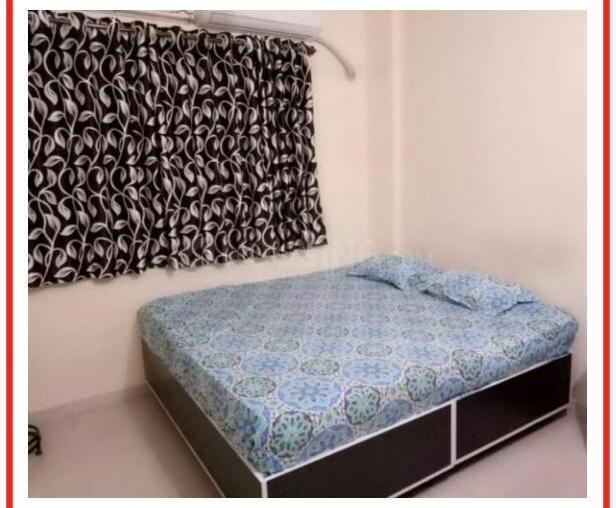 बेलापुर सीबीडी में ग्रीन हाउस होस्टल के बेडरूम की तस्वीर