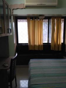 Gallery Cover Image of 800 Sq.ft 2 BHK Apartment for rent in Satellite Gardens, Goregaon East for 36000