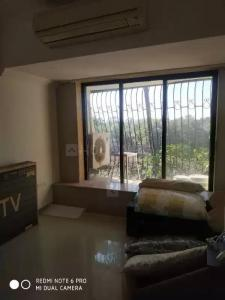 Gallery Cover Image of 1050 Sq.ft 2 BHK Apartment for buy in Rajkamal, Andheri West for 30000000