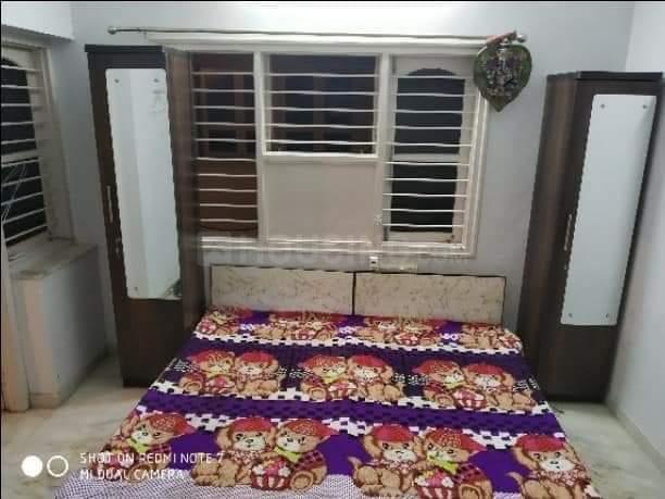 जोधपुर में ओम साई गर्ल्स पीजी के बेडरूम की तस्वीर