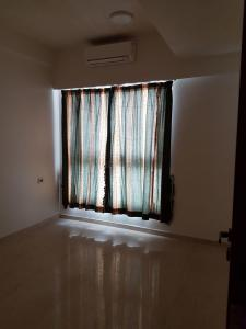 Gallery Cover Image of 585 Sq.ft 1 BHK Apartment for rent in Kandivali East for 22000