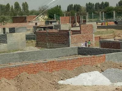 Gallery Cover Image of 630 Sq.ft Residential Plot for buy in Sector 143B for 805000