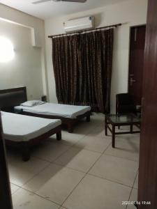 Bedroom Image of Vandana PG Stay in Sector 63