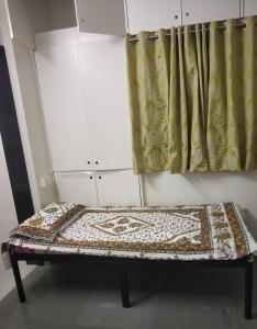 Bedroom Image of Deccan Hostel in Deccan Gymkhana