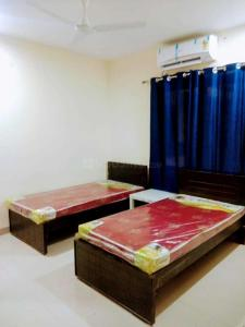 Bedroom Image of Adithya PG in Hafeezpet
