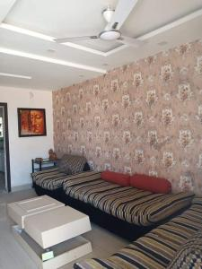 Gallery Cover Image of 800 Sq.ft 2 BHK Independent House for buy in Pumarth Meadows, Manglia for 2900000
