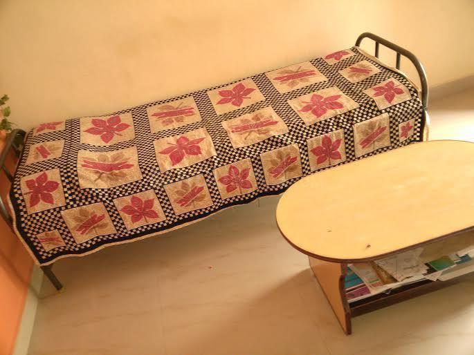 एचएसआर लेआउट में श्री साई पीजी फॉर जैंट्स में बेडरूम की तस्वीर