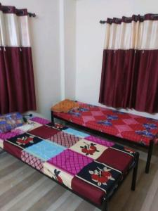 Bedroom Image of Om Sai Sneha PG in Kharadi