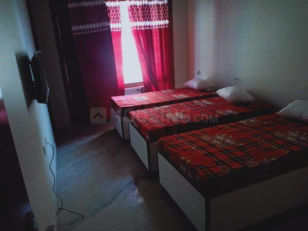 सेक्टर 32 में महादेव पीजी के बेडरूम की तस्वीर