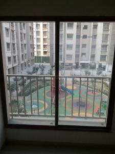 Gallery Cover Image of 630 Sq.ft 1 BHK Apartment for buy in Adani Aangan, Vaishno Devi Circle for 2500000