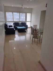 Gallery Cover Image of 950 Sq.ft 2 BHK Apartment for rent in Omkar Ananta, Goregaon East for 50000