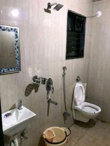 Bathroom Image of Working & Non Working Women's Hostel in Gokhalenagar