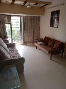 Gallery Cover Image of 1050 Sq.ft 2 BHK Apartment for rent in Sai Baba Enclave, Goregaon West for 45000