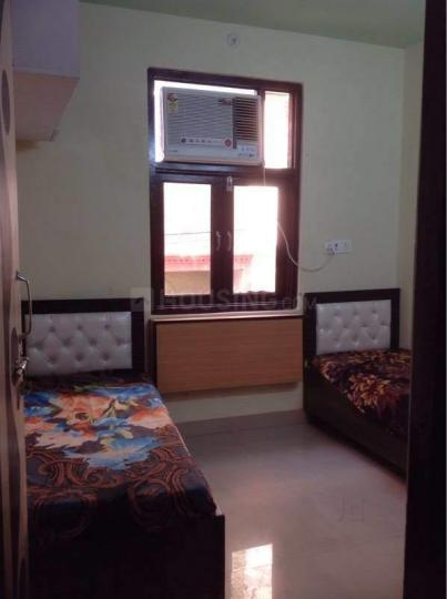 कमला नगर में बॉइज़ टाउन पीजी में बेडरूम की तस्वीर