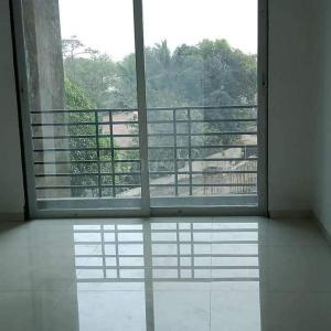 Gallery Cover Image of 695 Sq.ft 1 BHK Apartment for buy in Om Paraiso, Padle Gaon for 3500000