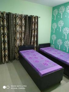 Bedroom Image of Dipansh PG in Sector 33