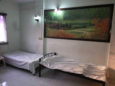 Bedroom Image of Poonam Real Estate's PG in Karve Nagar