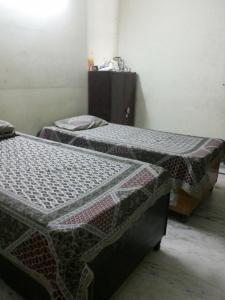 Bedroom Image of Guru Kripa PG in Sector 7 Rohini