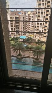 Gallery Cover Image of 780 Sq.ft 2 BHK Apartment for rent in ACME Ozone Phase 2, Thane West for 26000