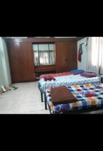 गोविंदपुरी में सिंह पीजी होम में बेडरूम की तस्वीर