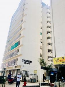 Gallery Cover Image of 1530 Sq.ft 3 BHK Apartment for rent in Golden Swarnim Square, Chharodi for 16000