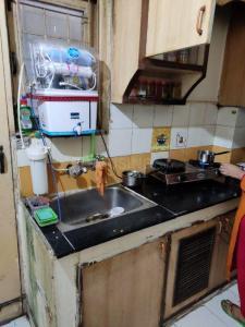 Kitchen Image of Royal PG in Shakti Khand