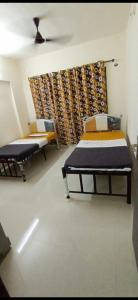 Bedroom Image of Oxotel,paying Guest Flats In Mumbai in Bhandup West