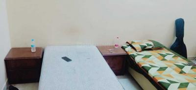 Bedroom Image of Home Living Boys PG in Laxmi Nagar