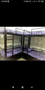 Bedroom Image of Royal Palace PG Hostel in Andheri West