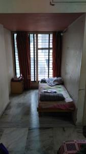 Bedroom Image of Ambika PG in Navrangpura