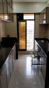 Gallery Cover Image of 1060 Sq.ft 2 BHK Apartment for rent in RNA NG Eclat, Andheri West for 75000
