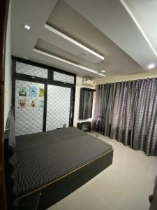 अंधेरी ईस्ट में पेइंग गेस्ट में बेडरूम की तस्वीर