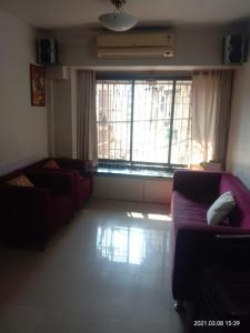 Gallery Cover Image of 945 Sq.ft 2 BHK Apartment for rent in Raj Paradise, Andheri East for 43000