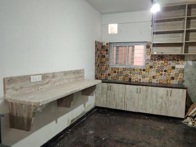 कममानहल्ली में पैसिफिक स्टे में किचन की तस्वीर