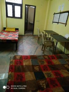 Bedroom Image of Nk Boys Hostel in Said-Ul-Ajaib