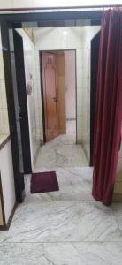 Gallery Cover Image of 515 Sq.ft 1 BHK Apartment for rent in Dhanlaxmi Cooperative Housing Society, Asalpha for 28000