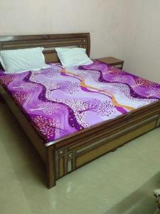 Bedroom Image of Laxmi House PG in Sector 49