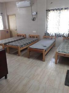 Bedroom Image of Metroinn in Santhome