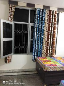 Bedroom Image of Welcome To Radhe PG in Lajpat Nagar