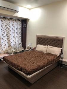 Gallery Cover Image of 1150 Sq.ft 2 BHK Apartment for rent in Kandivali East for 35000